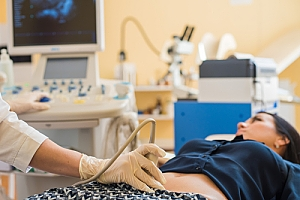 Woman laying on back during ultrasound