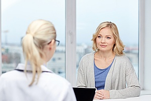 a doctor discussing menopause with a patient