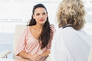 patient discussing her PAP smear results with a doctor