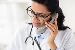 Doctor on phone scheduling follow up appointment