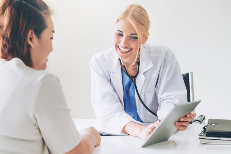 patient-looking-over-forms-with-doctor