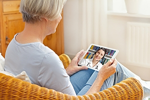 Woman consulting doctor on tablet telemedicine