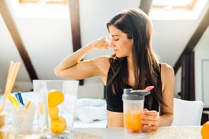 A healthy woman drinking citrus juice. Low immunity can harbor various gynecological issues in women.