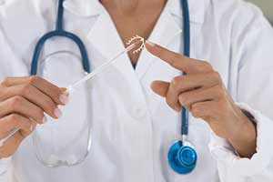 Raleigh gynecologist getting ready to insert IUDs