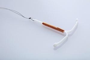 copper IUD on white background