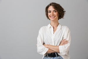 woman posing over grey wall background. Nexplanon is ideal for many women