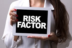 A woman holding a tablet with the text Risk Factor. Not all of the side effects are negative