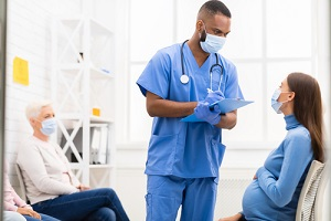 male nurse practitioner fixing patient appointment with doctor