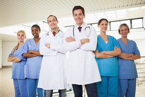 doctors with Nurse Practitioner with arms crossed in hospital corridor