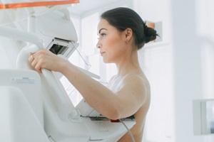 female patient undergoing mammogram screening procedure