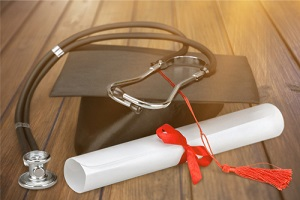 Nurse Practitioner degree with red ribbon and stethoscope