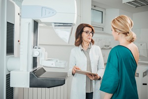 oncologist talking with her patient on mammography examination for her Breast Care