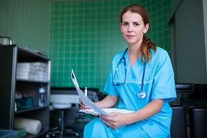 portrait of Nurse Practitioner holding medical report at the hospital