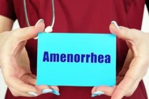 nurse holding amenorrhea card in hand for Menstrual Disorders
