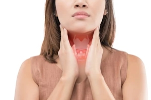 women hands on neck and thyroid glands because of a Menstrual Disorders