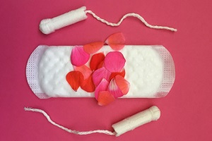 womans period showing flower petals on sanitary protection for Menstrual Disorders